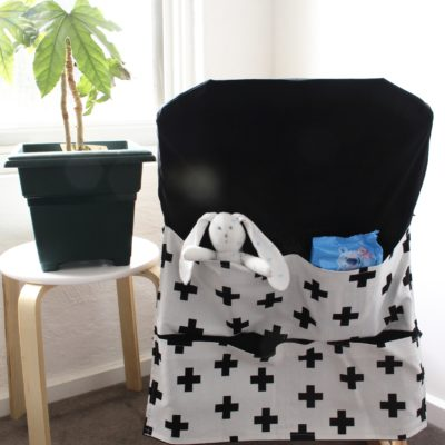 white with black cross high chair caddy
